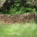 Stone wall next to track